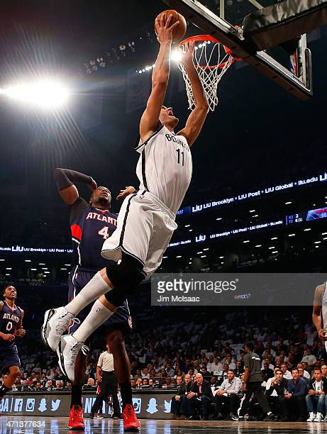 Brook Lopez of the Brooklyn Nets goes to the hoop in the first quarter against Paul Millsap of the Atlanta Hawks during game four in the first round...