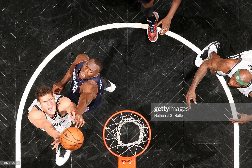 Brook Lopez #11 of the Brooklyn Nets goes up for a rebound against <a gi-track='captionPersonalityLinkClicked' href=/galleries/search?phrase=Bismack+Biyombo&family=editorial&specificpeople=7640443 ng-click='$event.stopPropagation()'>Bismack Biyombo</a> #0 of the Charlotte Bobcats on April 6, 2013 at the Barclays Center in the Brooklyn borough of New York City.