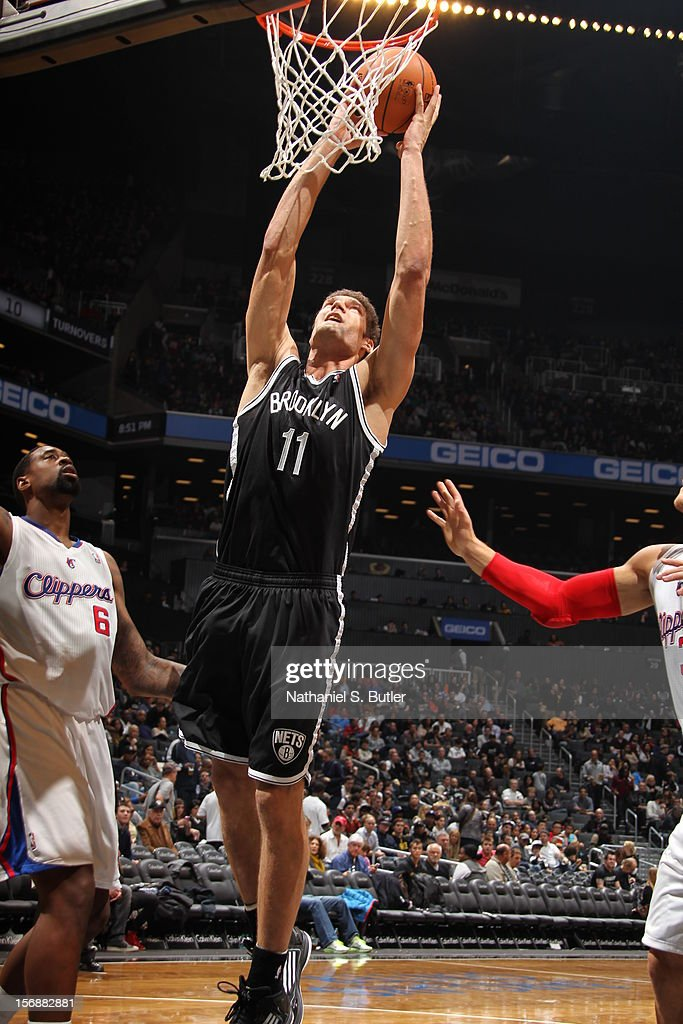 Brook Lopez #11 of the Brooklyn Nets goes up for the dunk against the Los Angeles Clippers on November 23, 2012 at the Barclays Center in the Brooklyn Borough of New York City.