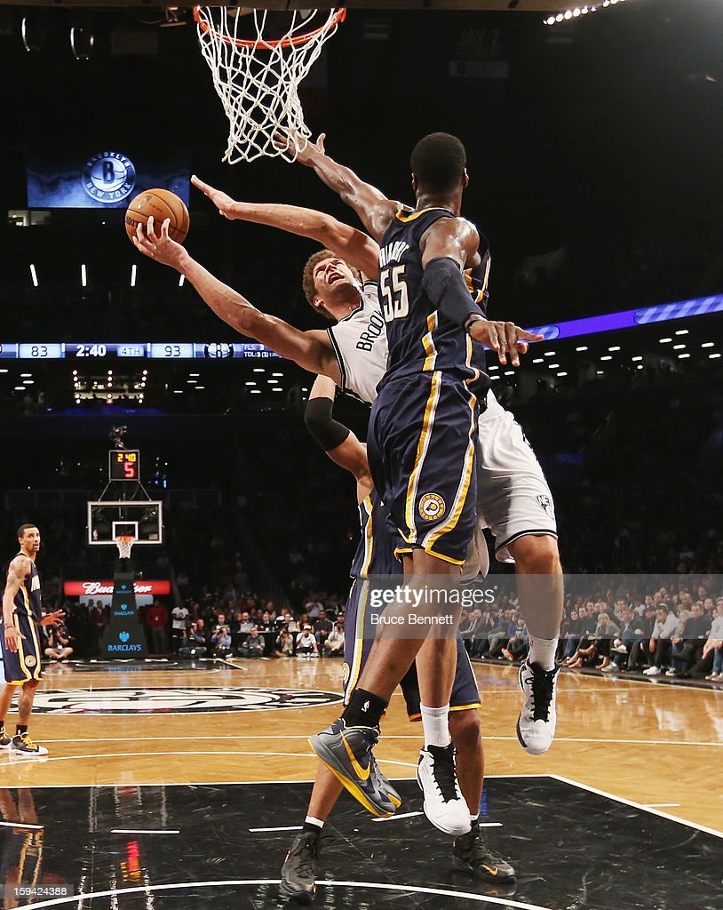 Brook Lopez #11 of the Brooklyn Nets goes up to attempt two against Roy Hibbert #55 of the Indiana Pacers in the fourth quarter at the Barclays Center on January 13, 2013 in New York City.