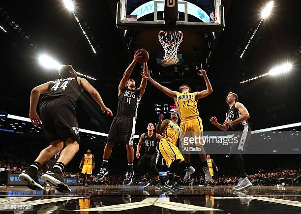 Brook Lopez of the Brooklyn Nets grabs a rebound against Georges Niang of the Indiana Pacers during their game at the Barclays Center on October 28...