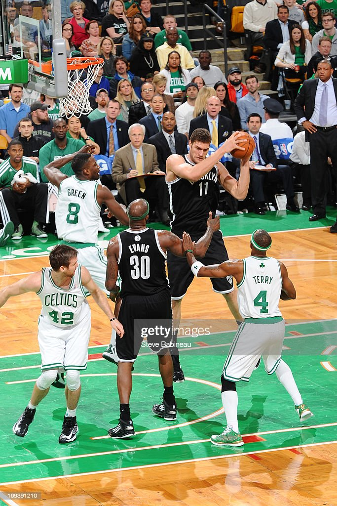 <a gi-track='captionPersonalityLinkClicked' href=/galleries/search?phrase=Brook+Lopez&family=editorial&specificpeople=3847328 ng-click='$event.stopPropagation()'>Brook Lopez</a> #11 of the Brooklyn Nets grabs a rebound against the Boston Celtics on April 10, 2013 at the TD Garden in Boston, Massachusetts.