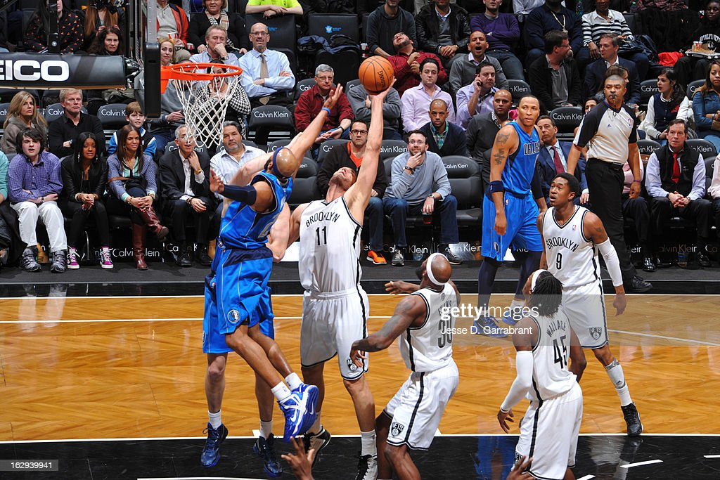 Brook Lopez #11 of the Brooklyn Nets grabs a rebound against the Dallas Mavericks on March 1, 2013 at the Barclays Center in Brooklyn, New York.