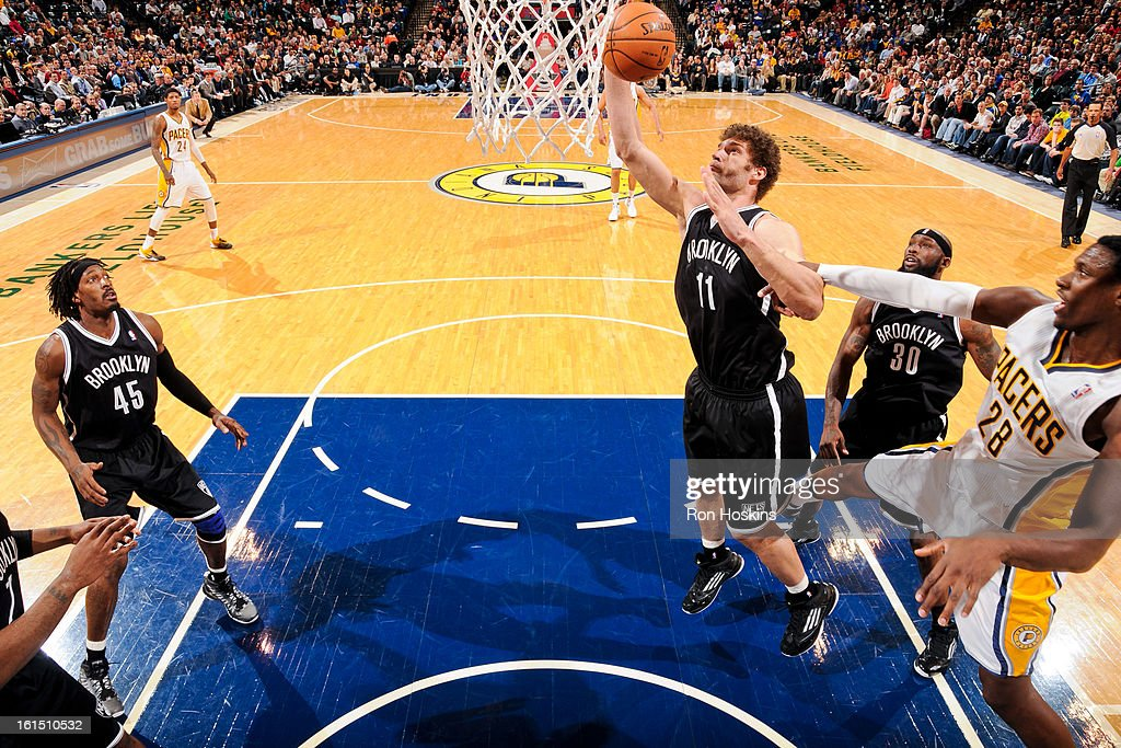 Brook Lopez #11 of the Brooklyn Nets grabs a rebound against the Indiana Pacers on February 11, 2013 at Bankers Life Fieldhouse in Indianapolis, Indiana.