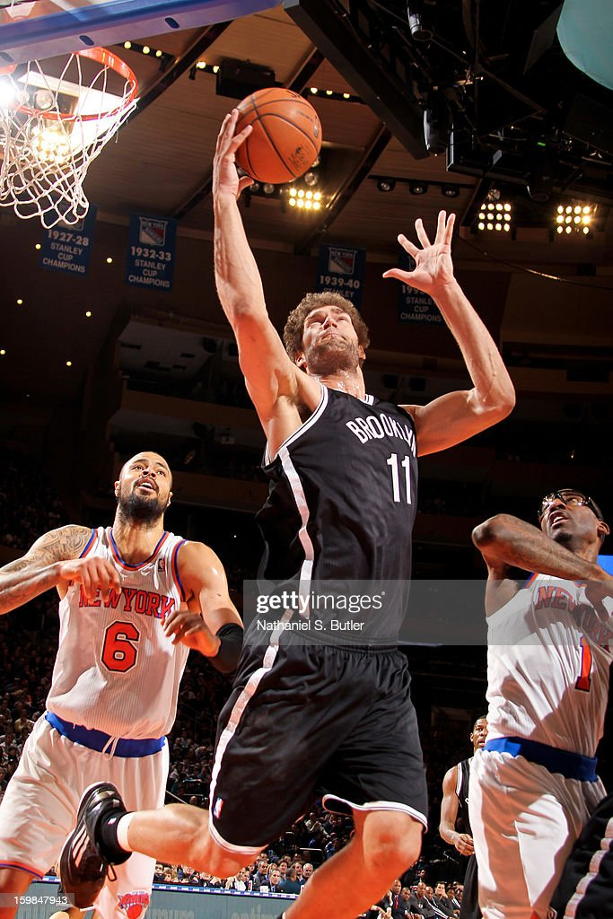Brook Lopez #11 of the Brooklyn Nets grabs a rebound against Tyson Chandler #6 and Amar'e Stoudemire #1 of the New York Knicks on January 21, 2013 at Madison Square Garden in New York City.