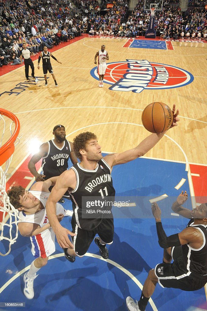 Brook Lopez of the Brooklyn Nets grabs a rebound against Viacheslav Kravtsov of the Detroit Pistons on February 6 2013 at The Palace of Auburn Hills...