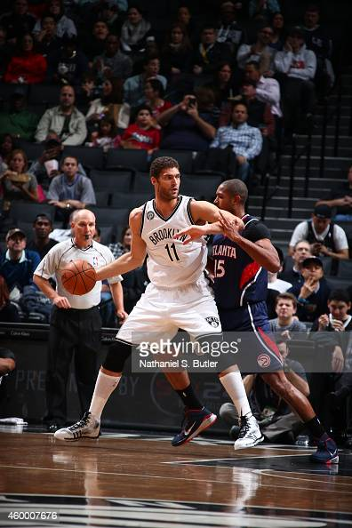 Brook Lopez of the Brooklyn Nets handles the ball against Al Horford of the Atlanta Hawks on December 5 2014 at the Barclays Center in the Brooklyn...