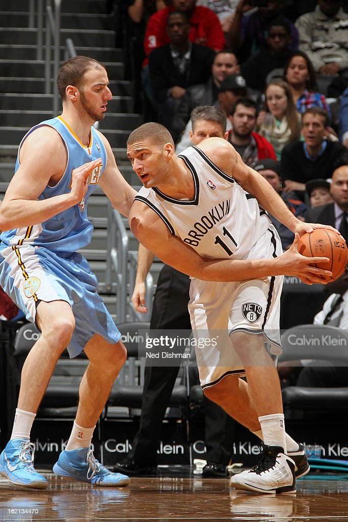 Brook Lopez #11 of the Brooklyn Nets handles the ball against Kosta Koufos #41 of the Denver Nuggets on February 13, 2013 at the Barclays Center in the Brooklyn borough of New York City in New York City.