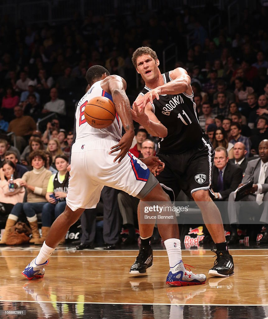 Brook Lopez #11 of the Brooklyn Nets has his pass blocked by DeAndre Jordan #6 of the Los Angeles Clippers at the Barclays Center on November 23, 2012 in the Brooklyn borough of New York City.