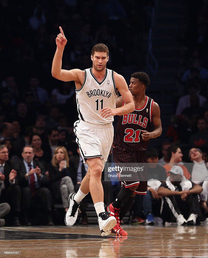 Brook Lopez of the Brooklyn Nets hits a three pointer in the first quarter against the Chicago Bulls at the Barclays Center on April 4 2013 in New...