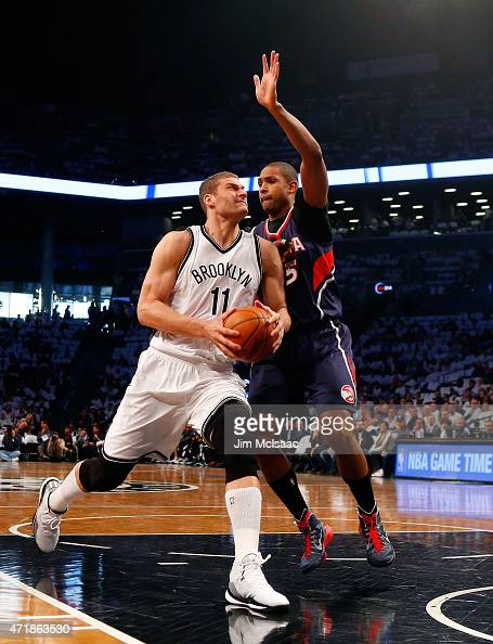 Brook Lopez of the Brooklyn Nets in action against Al Horford of the Atlanta Hawks during game four in the first round of the 2015 NBA Playoffs at...
