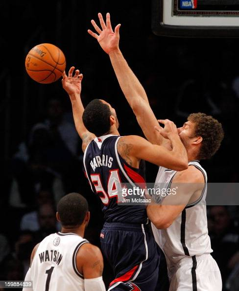Brook Lopez of the Brooklyn Nets in action against Devin Harris of the Atlanta Hawks at Barclays Center on January 18 2013 in the Brooklyn borough of...