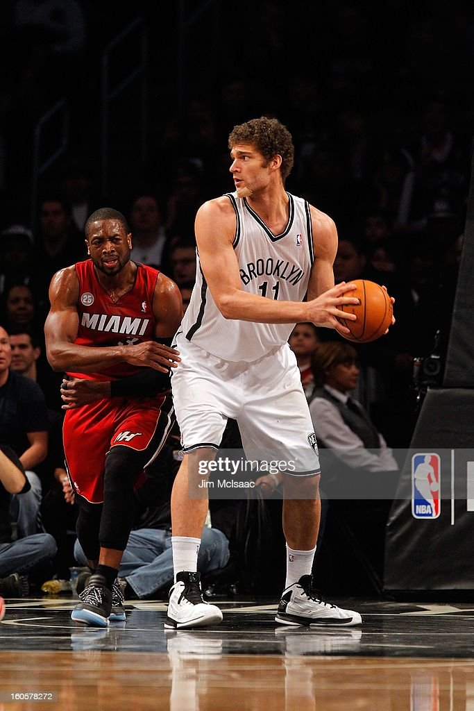 Brook Lopez #11 of the Brooklyn Nets in action against Dwyane Wade #3 of the Miami Heat at Barclays Center on January 30, 2013 in the Brooklyn borough of New York City.The Heat defeated the Nets 105-85.