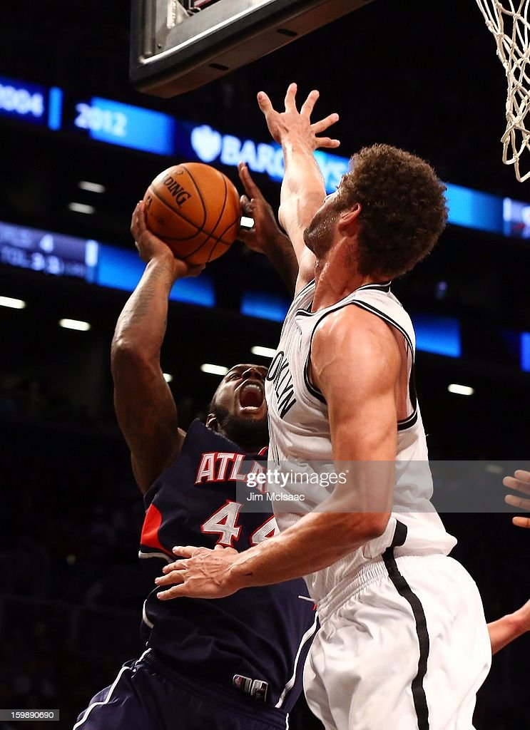 Brook Lopez #11 of the Brooklyn Nets in action against Ivan Johnson #44 of the Atlanta Hawks at Barclays Center on January 18, 2013 in the Brooklyn borough of New York City.The Nets defeated the Hawks 94-89.