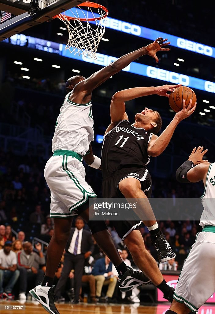 Brook Lopez #11 of the Brooklyn Nets in action against Kevin Garnett #5 of the Boston Celtics during a preseason game at the Barclays Center on October 18, 2012 in the Brooklyn borough of New York City. The Celtics defeated the Nets 115-85.