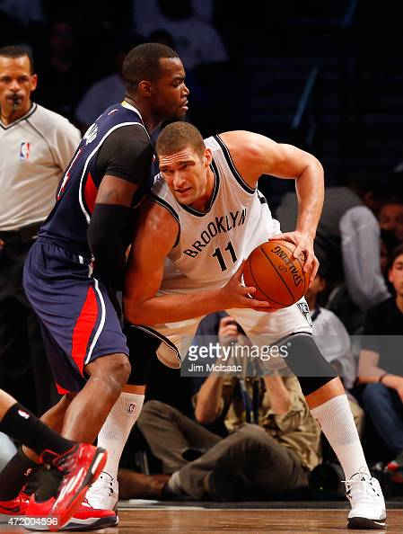 Brook Lopez of the Brooklyn Nets in action against Paul Millsap of the Atlanta Hawks during game four in the first round of the 2015 NBA Playoffs at...