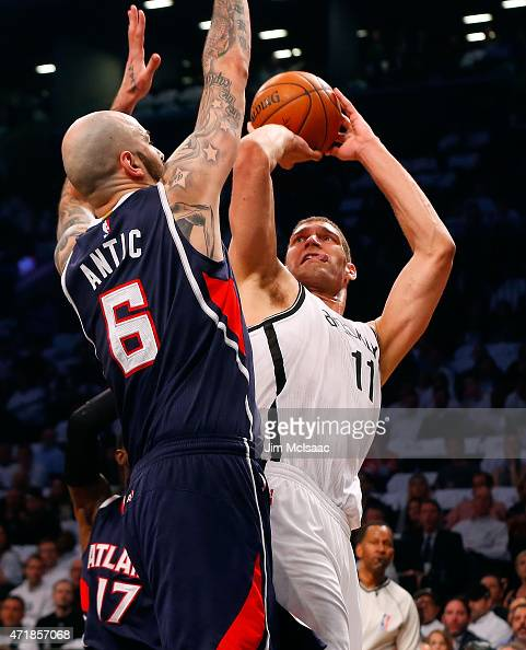 Brook Lopez of the Brooklyn Nets in action against Pero Antic of the Atlanta Hawks during game four in the first round of the 2015 NBA Playoffs at...