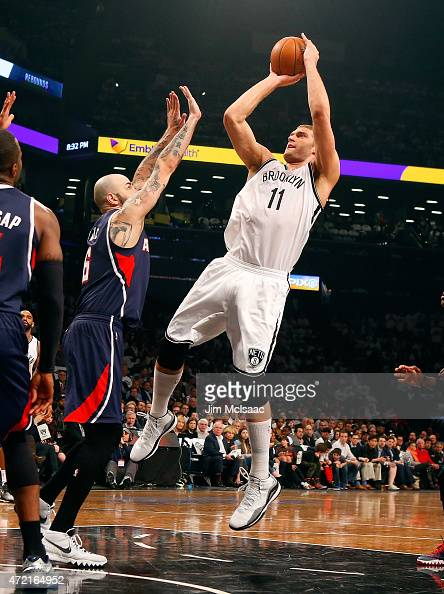Brook Lopez of the Brooklyn Nets in action against Pero Antic of the Atlanta Hawks during game six in the first round of the 2015 NBA Playoffs at...