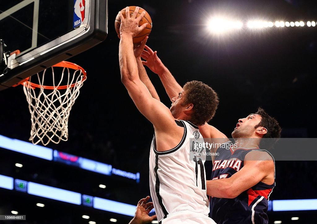 Brook Lopez #11 of the Brooklyn Nets in action against Zaza Pachulia #27 of the Atlanta Hawks at Barclays Center on January 18, 2013 in the Brooklyn borough of New York City.The Nets defeated the Hawks 94-89.