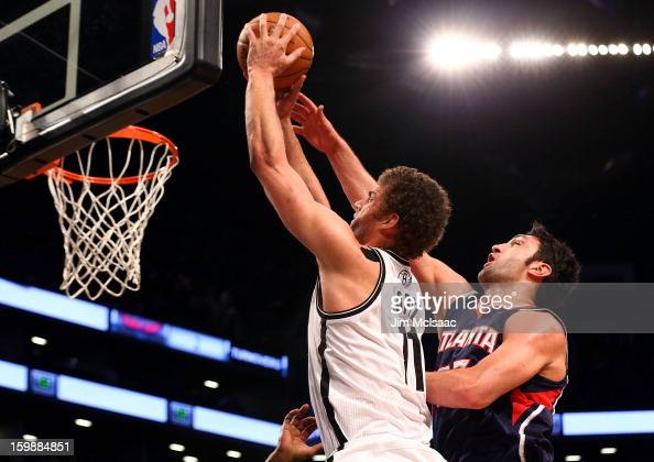 Brook Lopez of the Brooklyn Nets in action against Zaza Pachulia of the Atlanta Hawks at Barclays Center on January 18 2013 in the Brooklyn borough...