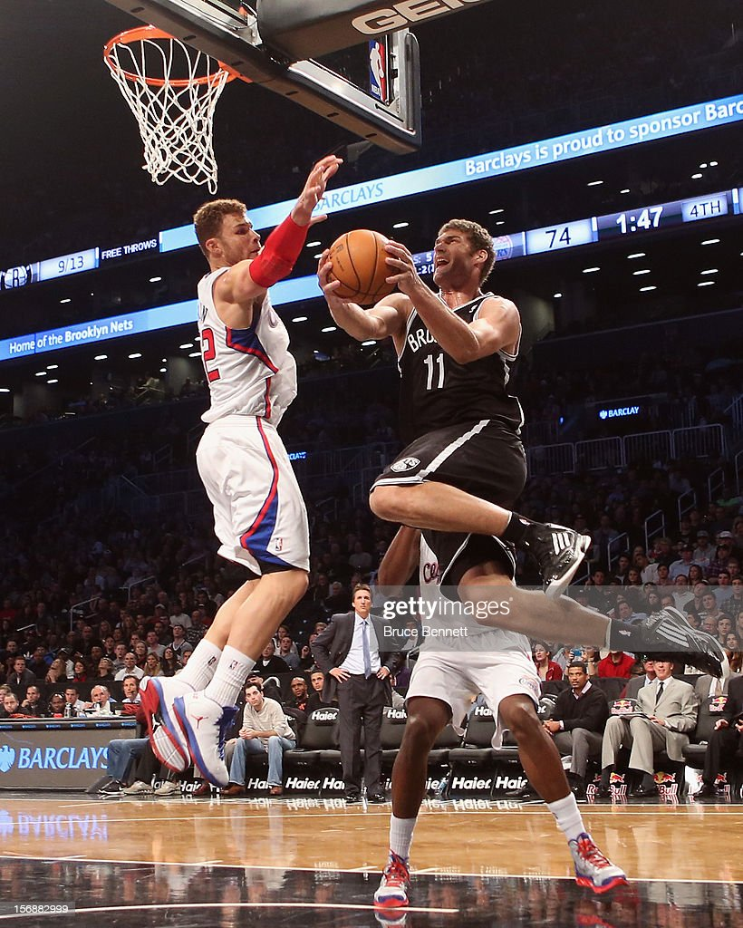 Brook Lopez #11 of the Brooklyn Nets is blocked by <a gi-track='captionPersonalityLinkClicked' href=/galleries/search?phrase=Blake+Griffin&family=editorial&specificpeople=4216010 ng-click='$event.stopPropagation()'>Blake Griffin</a> #32 of the Los Angeles Clippers at the Barclays Center on November 23, 2012 in the Brooklyn borough of New York City.