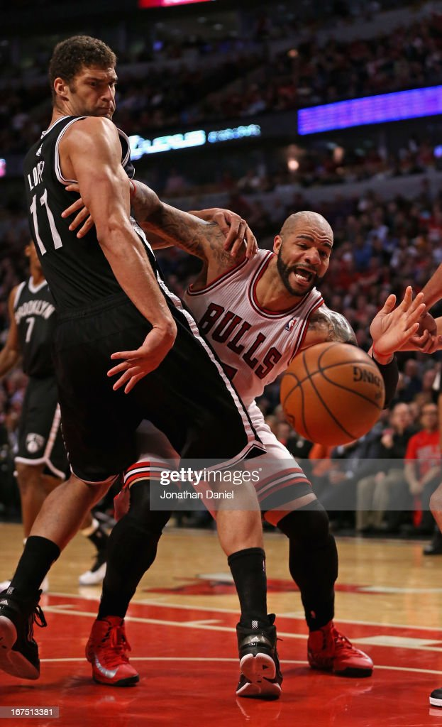 <a gi-track='captionPersonalityLinkClicked' href=/galleries/search?phrase=Brook+Lopez&family=editorial&specificpeople=3847328 ng-click='$event.stopPropagation()'>Brook Lopez</a> #11 of the Brooklyn Nets knocks the ball away from <a gi-track='captionPersonalityLinkClicked' href=/galleries/search?phrase=Carlos+Boozer&family=editorial&specificpeople=201638 ng-click='$event.stopPropagation()'>Carlos Boozer</a> #5 of the Chicago Bulls in Game Three of the Eastern Conference Quarterfinals during the 2013 NBA Playoffs at the United Center on April 25, 2013 in Chicago, Illinois. The Bulls defeated the Nets 79-76.