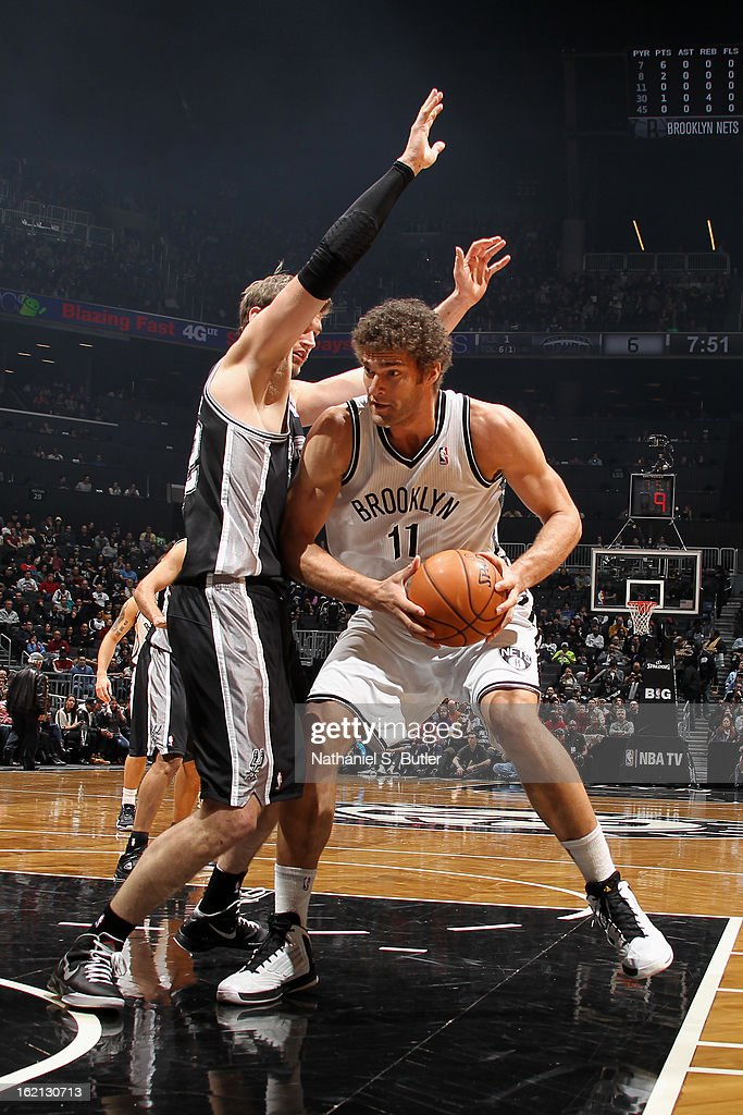 Brook Lopez #11 of the Brooklyn Nets looks to drive to the basket against the San Antonio Spurs on February 10, 2013 at the Barclays Center in the Brooklyn borough of New York City.