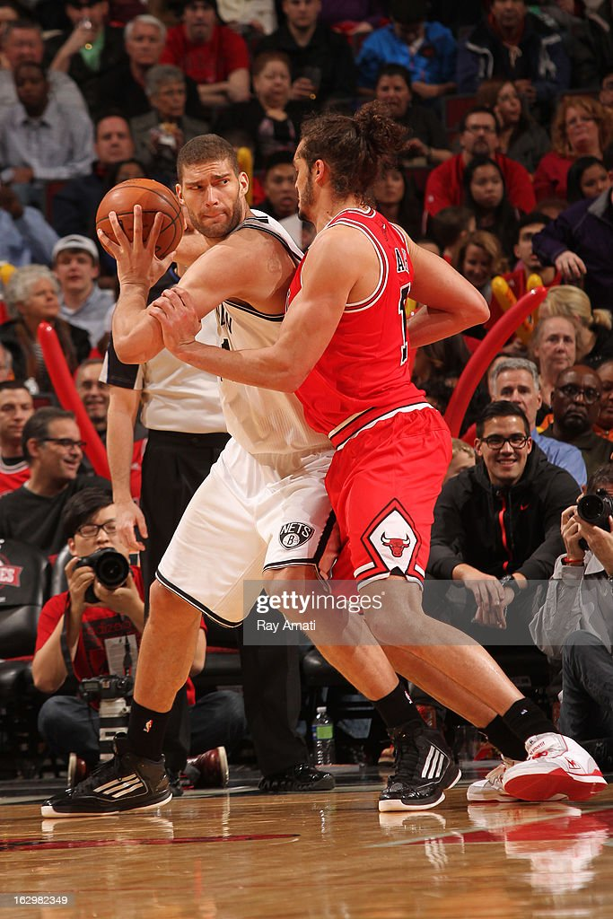 <a gi-track='captionPersonalityLinkClicked' href=/galleries/search?phrase=Brook+Lopez&family=editorial&specificpeople=3847328 ng-click='$event.stopPropagation()'>Brook Lopez</a> #11 of the Brooklyn Nets looks to pass the ball against <a gi-track='captionPersonalityLinkClicked' href=/galleries/search?phrase=Joakim+Noah&family=editorial&specificpeople=699038 ng-click='$event.stopPropagation()'>Joakim Noah</a> #13 of the Chicago Bulls on March 2, 2013 at the United Center in Chicago, Illinois.