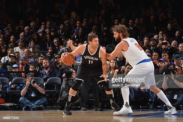 Brook Lopez of the Brooklyn Nets looks to score against Robin Lopez of the New York Knicks at Madison Square Garden on December 4 2015 in New YorkNew...