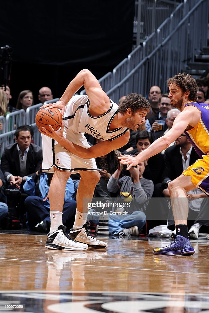 <a gi-track='captionPersonalityLinkClicked' href=/galleries/search?phrase=Brook+Lopez&family=editorial&specificpeople=3847328 ng-click='$event.stopPropagation()'>Brook Lopez</a> #11 of the Brooklyn Nets makes a move against <a gi-track='captionPersonalityLinkClicked' href=/galleries/search?phrase=Pau+Gasol&family=editorial&specificpeople=201587 ng-click='$event.stopPropagation()'>Pau Gasol</a> #16 of the Los Angeles Lakers on February 5, 2013 at the Barclays Center in the Brooklyn borough of New York City.
