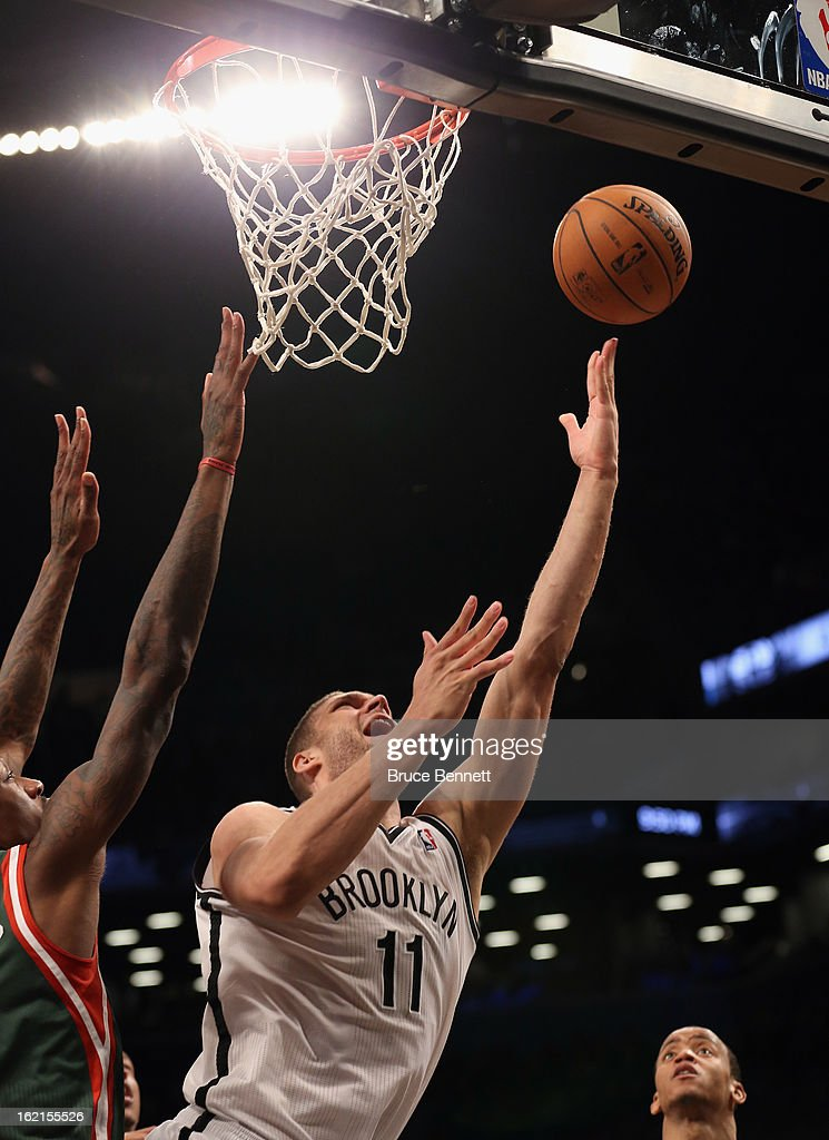 Brook Lopez #11 of the Brooklyn Nets misses a shot in overtime in the game against the Milwaukee Bucks at the Barclays Center on February 19, 2013 in New York City.