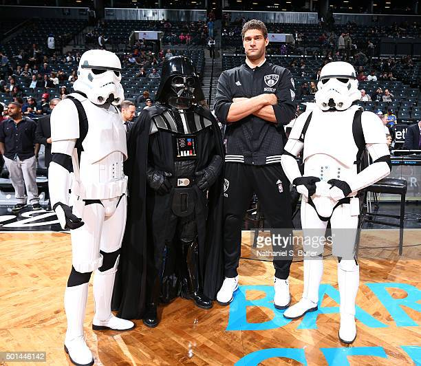 Brook Lopez of the Brooklyn Nets poses for a photo with Star Wars characters during a game between the Orlando Magic and the Brooklyn Nets on...