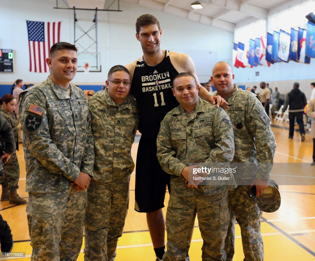 Brook Lopez #11 of the Brooklyn Nets poses for a picture during a team event in celebration of Veterans Day at Ft. Hamilton, Brooklyn on November 11, 2013 in the Brooklyn borough of New York City.