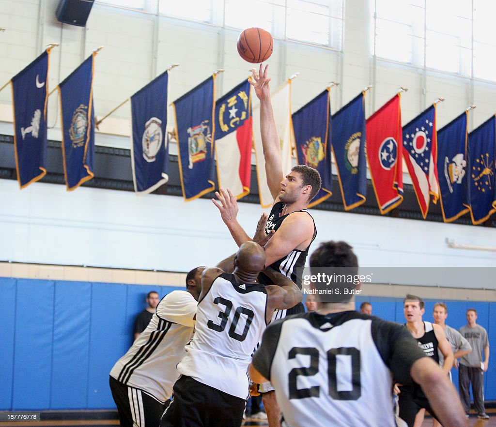 Brook Lopez #11 of the Brooklyn Nets practices during a team event in celebration of Veterans Day at Ft. Hamilton, Brooklyn on November 11, 2013 in the Brooklyn borough of New York City.