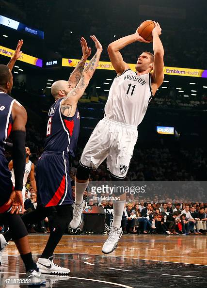 Brook Lopez of the Brooklyn Nets puts up a shot in the first half against Pero Antic of the Atlanta Hawks during game six in the first round of the...