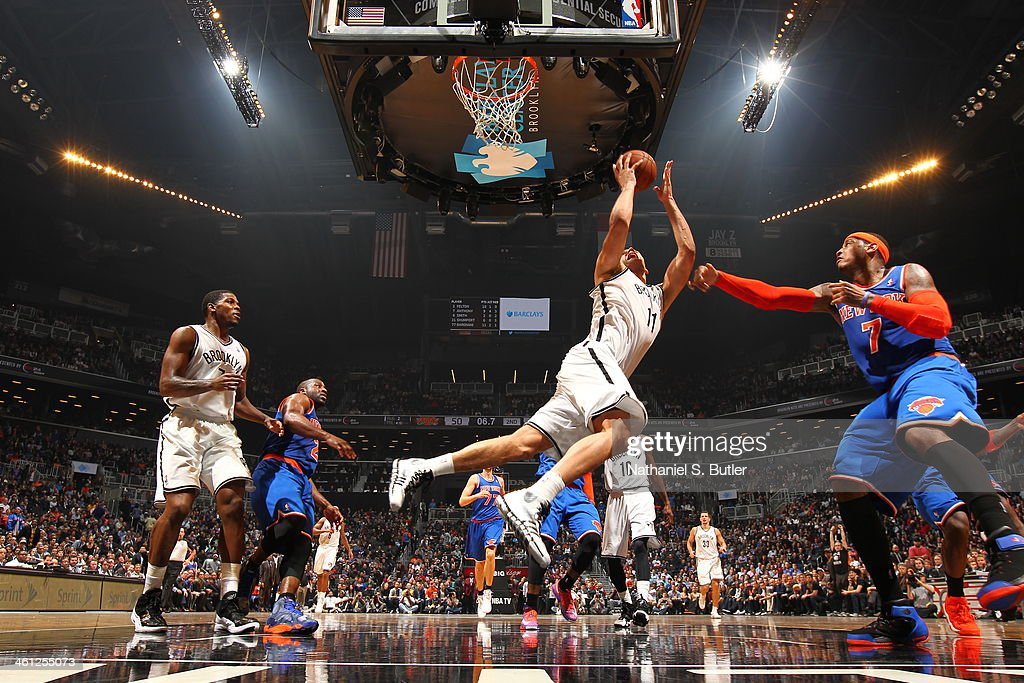 <a gi-track='captionPersonalityLinkClicked' href=/galleries/search?phrase=Brook+Lopez&family=editorial&specificpeople=3847328 ng-click='$event.stopPropagation()'>Brook Lopez</a> #11 of the Brooklyn Nets reaching out for a layup in a game against the New York Knicks during a game at Barclays Center on December 5, 2013 in the Brooklyn borough of New York City.