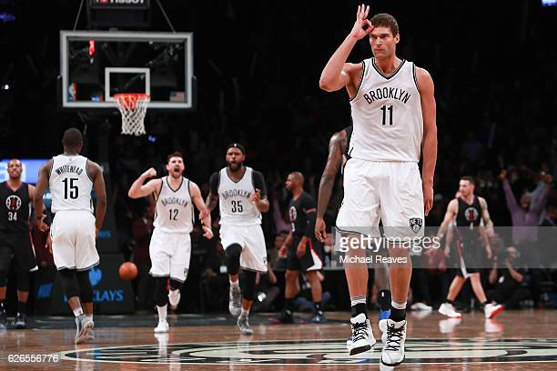 Brook Lopez of the Brooklyn Nets reacts after hitting a three pointer against the Los Angeles Clippers in the second half at Barclays Center on...