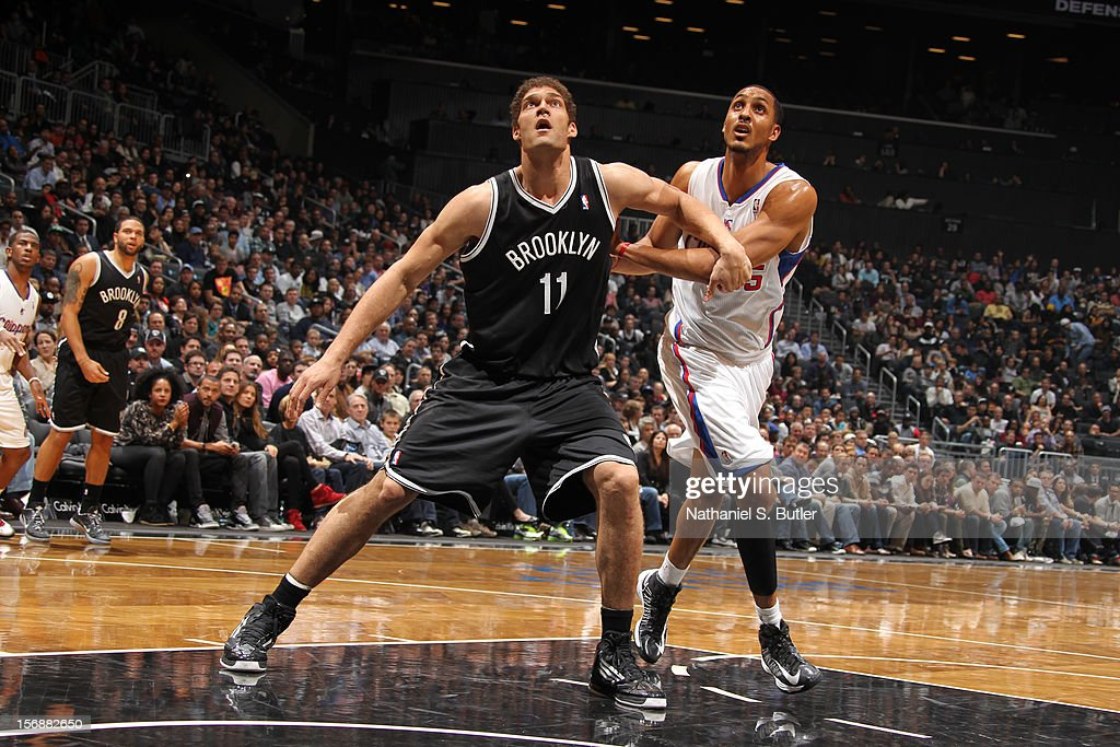 Brook Lopez #11 of the Brooklyn Nets rebounds against Ryan Hollins #15 of the Los Angeles Clippers on November 23, 2012 at the Barclays Center in the Brooklyn Borough of New York City.