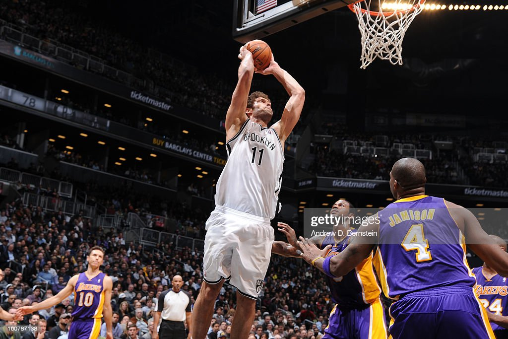 Brook Lopez #11 of the Brooklyn Nets rises for a dunk against Earl Clark #6 and Antawn Jamison #4 of the Los Angeles Lakers on February 5, 2013 at the Barclays Center in the Brooklyn borough of New York City.
