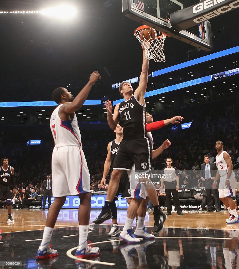 Brook Lopez #11 of the Brooklyn Nets scores two in the third quarter against the Los Angeles Clippers at the Barclays Center on November 23, 2012 in the Brooklyn borough of New York City.