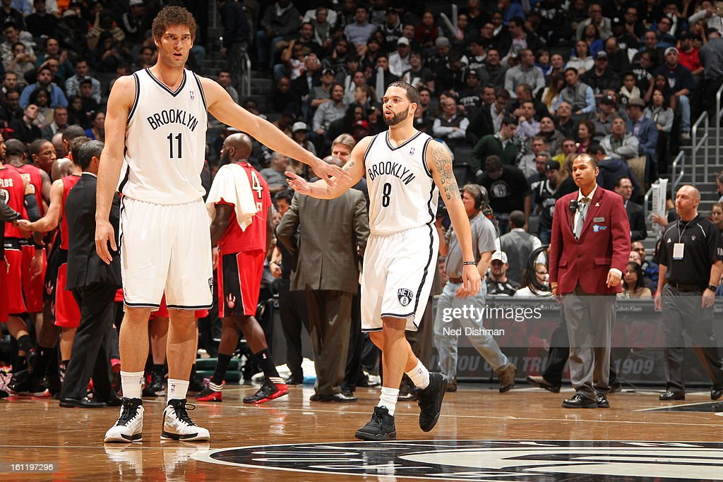 <a gi-track='captionPersonalityLinkClicked' href=/galleries/search?phrase=Brook+Lopez&family=editorial&specificpeople=3847328 ng-click='$event.stopPropagation()'>Brook Lopez</a> #11 of the Brooklyn Nets shakes hands with <a gi-track='captionPersonalityLinkClicked' href=/galleries/search?phrase=Deron+Williams&family=editorial&specificpeople=203215 ng-click='$event.stopPropagation()'>Deron Williams</a> #8 during a timeout against the Toronto Raptors at the Barclays Center on January 15, 2013 in the Brooklyn borough of New York City in New York City.
