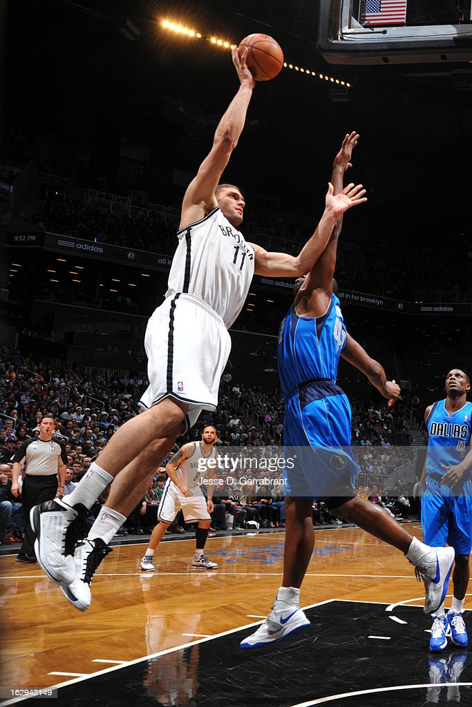 Brook Lopez #11 of the Brooklyn Nets shoots a layup against Elton Brand #42 of the Dallas Mavericks on March 1, 2013 at the Barclays Center in Brooklyn, New York.
