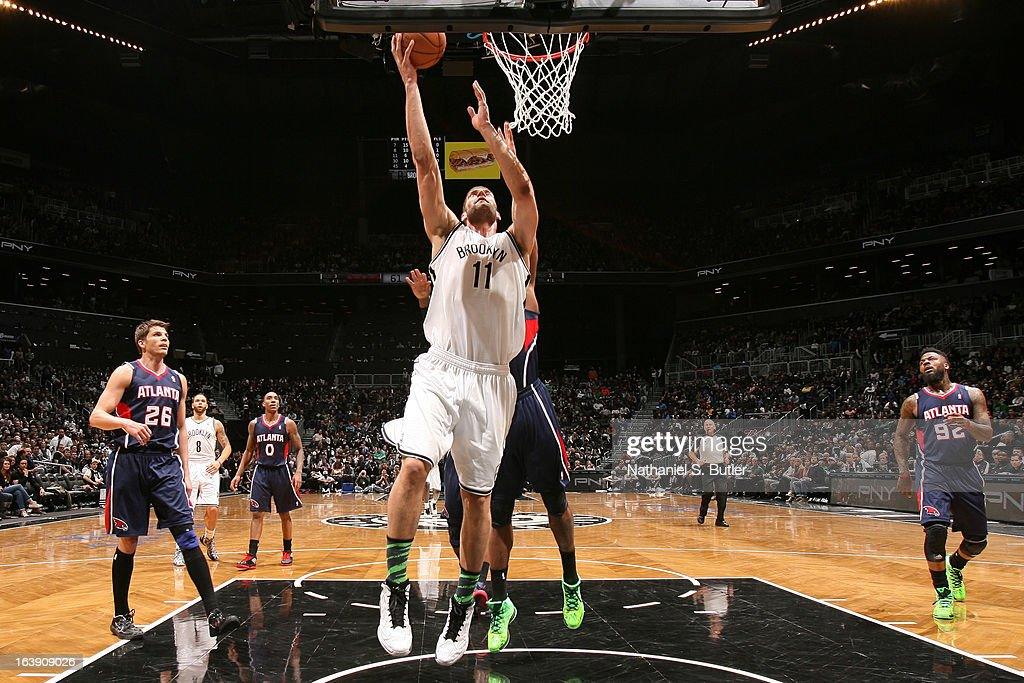 Brook Lopez #11 of the Brooklyn Nets shoots a layup against the Atlanta Hawks on March 17, 2013 at the Barclays Center in the Brooklyn borough of New York City.