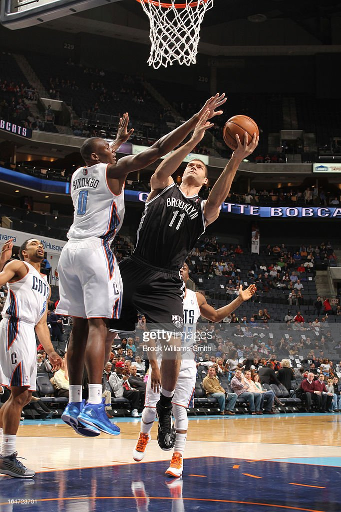 Brook Lopez #11 of the Brooklyn Nets shoots against <a gi-track='captionPersonalityLinkClicked' href=/galleries/search?phrase=Bismack+Biyombo&family=editorial&specificpeople=7640443 ng-click='$event.stopPropagation()'>Bismack Biyombo</a> #0 of the Charlotte Bobcats at the Time Warner Cable Arena on March 6, 2013 in Charlotte, North Carolina.