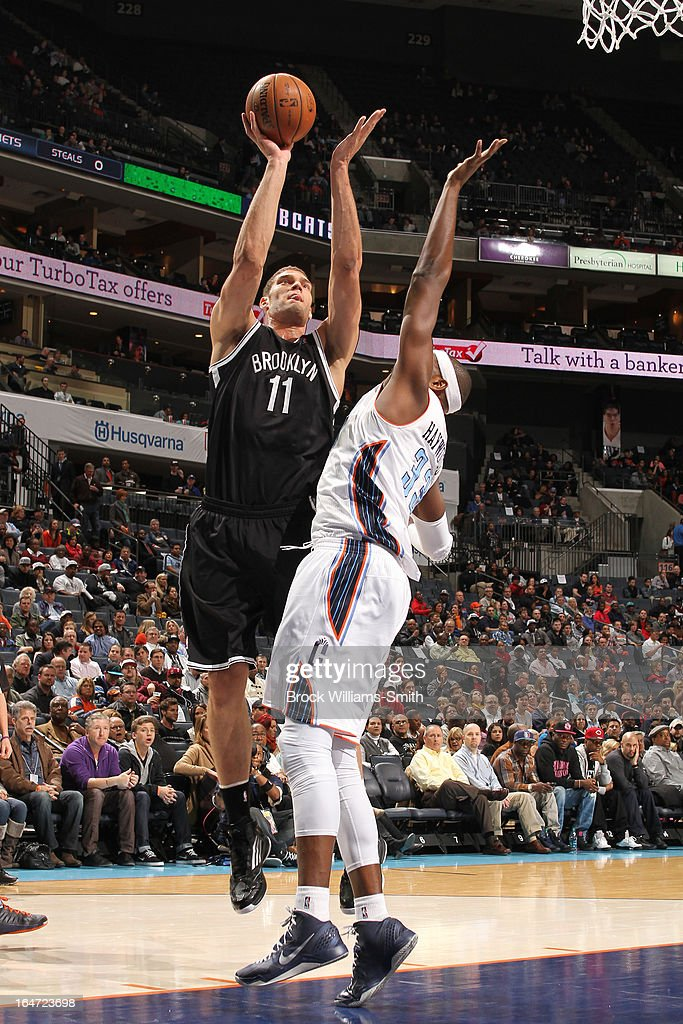 Brook Lopez #11 of the Brooklyn Nets shoots against <a gi-track='captionPersonalityLinkClicked' href=/galleries/search?phrase=Brendan+Haywood&family=editorial&specificpeople=202010 ng-click='$event.stopPropagation()'>Brendan Haywood</a> #33 of the Charlotte Bobcats at the Time Warner Cable Arena on March 6, 2013 in Charlotte, North Carolina.
