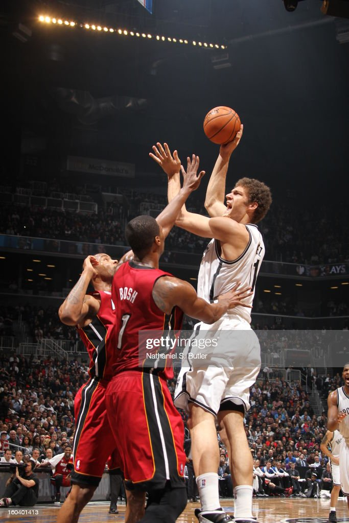 Brook Lopez #11 of the Brooklyn Nets shoots against Chris Bosh #1 of the Miami Heat on January 30, 2013 at the Barclays Center in the Brooklyn borough of New York City.