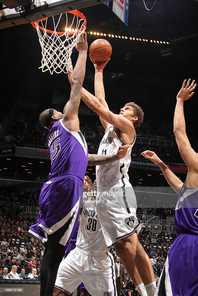 Brook Lopez #11 of the Brooklyn Nets shoots against DeMarcus Cousins #15 of the Sacramento Kings on January 5, 2013 at the Barclays Center in the Brooklyn borough of New York City.