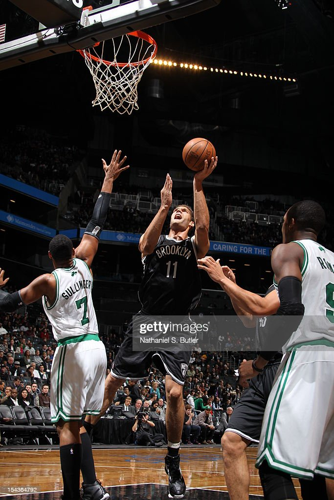 Brook Lopez #11 of the Brooklyn Nets shoots against <a gi-track='captionPersonalityLinkClicked' href=/galleries/search?phrase=Jared+Sullinger&family=editorial&specificpeople=6866665 ng-click='$event.stopPropagation()'>Jared Sullinger</a> #7 of the Boston Celtics during a pre-season game on October 18, 2012 at the Barclays Center in the Brooklyn borough of New York City.