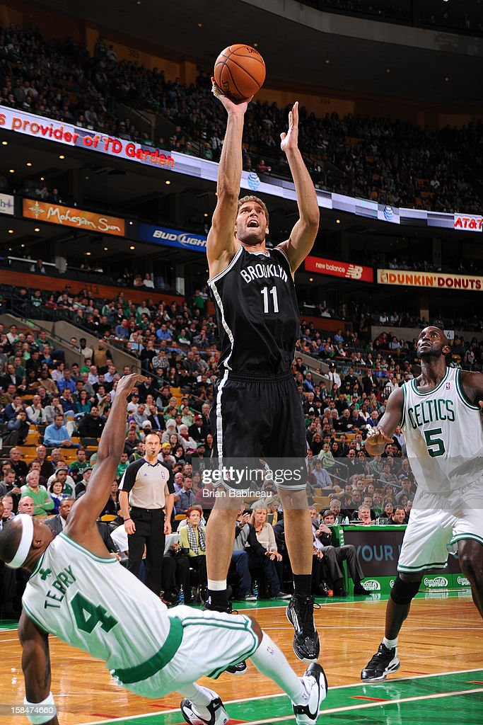 Brook Lopez #11 of the Brooklyn Nets shoots against <a gi-track='captionPersonalityLinkClicked' href=/galleries/search?phrase=Jason+Terry&family=editorial&specificpeople=201734 ng-click='$event.stopPropagation()'>Jason Terry</a> #4 of the Boston Celtics on November 28, 2012 at the TD Garden in Boston, Massachusetts.