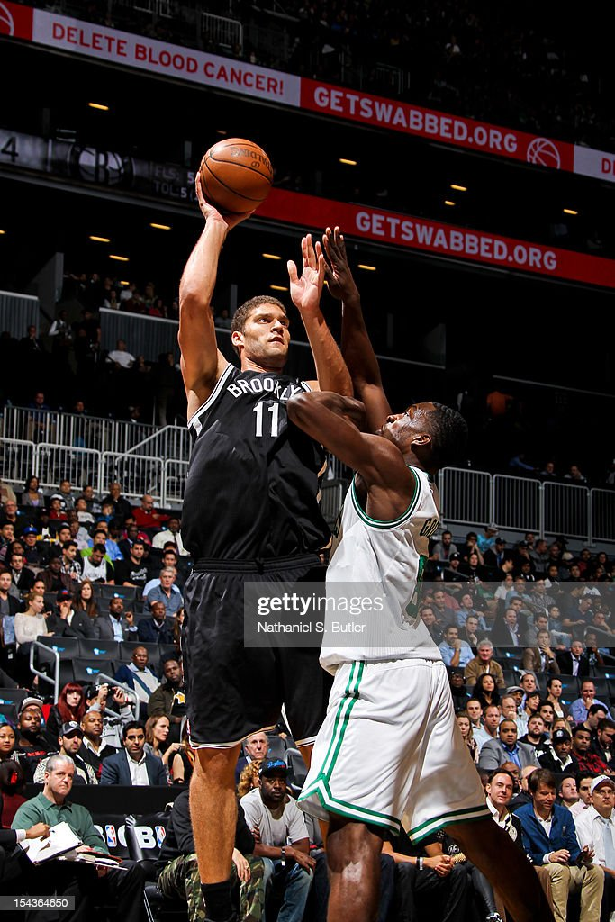 Brook Lopez #11 of the Brooklyn Nets shoots against Jeff Green #8 of the Boston Celtics during a pre-season game on October 18, 2012 at the Barclays Center in the Brooklyn borough of New York City.